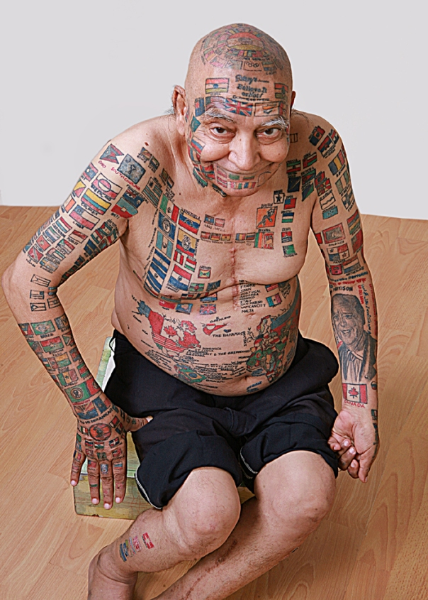 man-tattoos-his-body-with-flags
